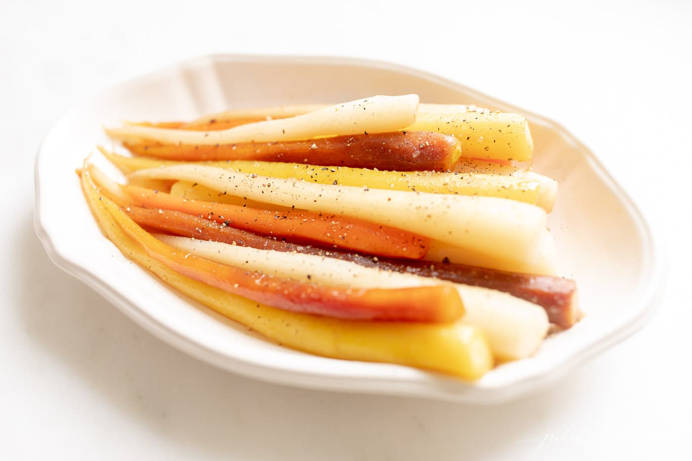 cooked carrots in ivory dish