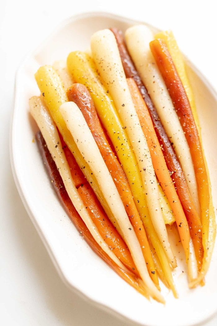 These Candied Carrots are a simple, sweet and savory brunch or dinner menu addition. Coated in a butter and brown sugar glaze, this Candied Carrots Recipe is the ultimate side dish for Easter and beyond!  #candiedcarrots #easterrecipe #carrots