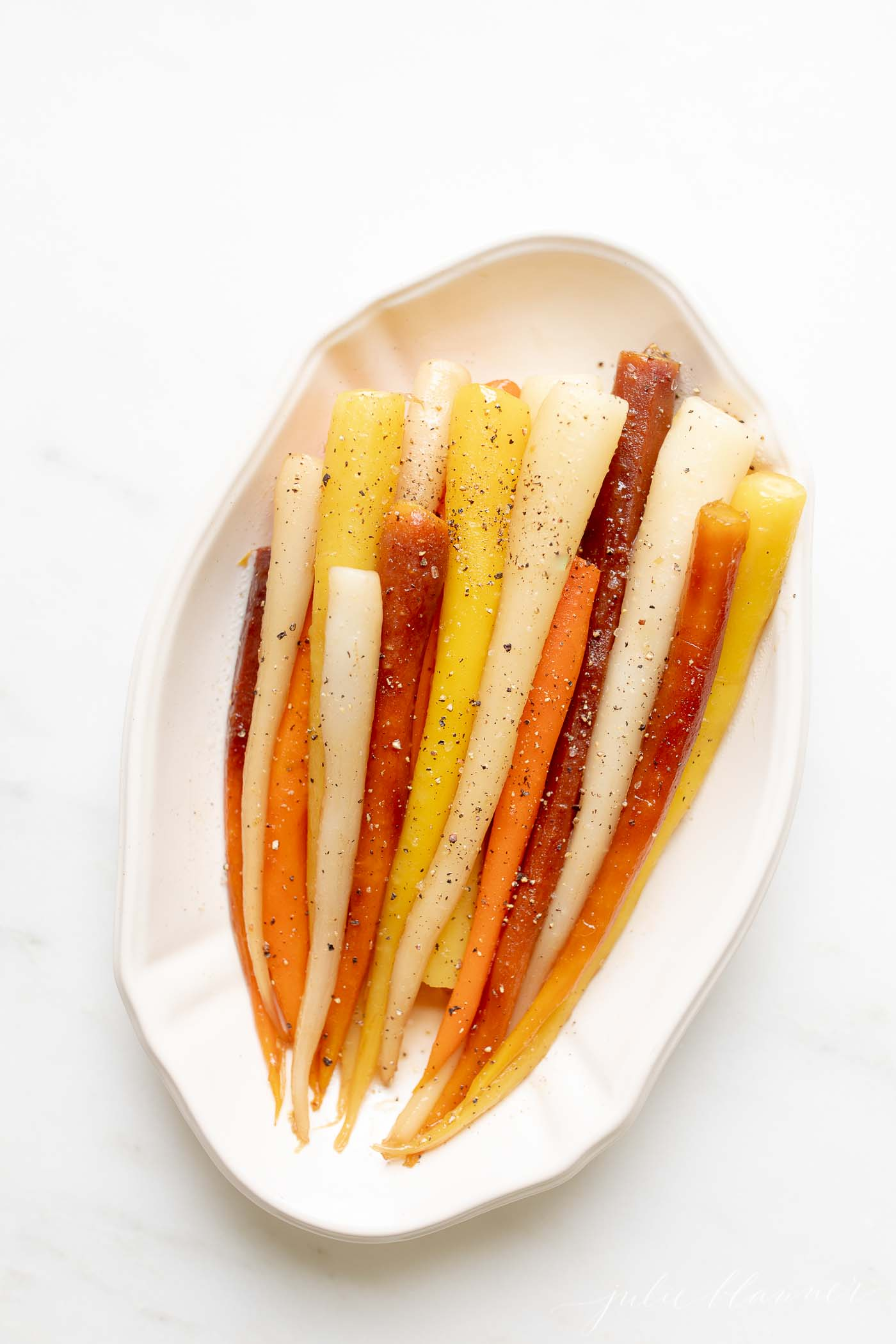 heirloom carrots in a serving dish