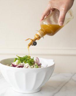 Sherry Vinaigrette pouring onto salad