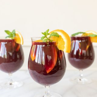 Authentic Spanish Sangria Recipe with dry Spanish red wine, filled with lemons, limes, oranges and more. This Sangria Punch is perfect for summertime parties and serves beautifully in a glass pitcher.
