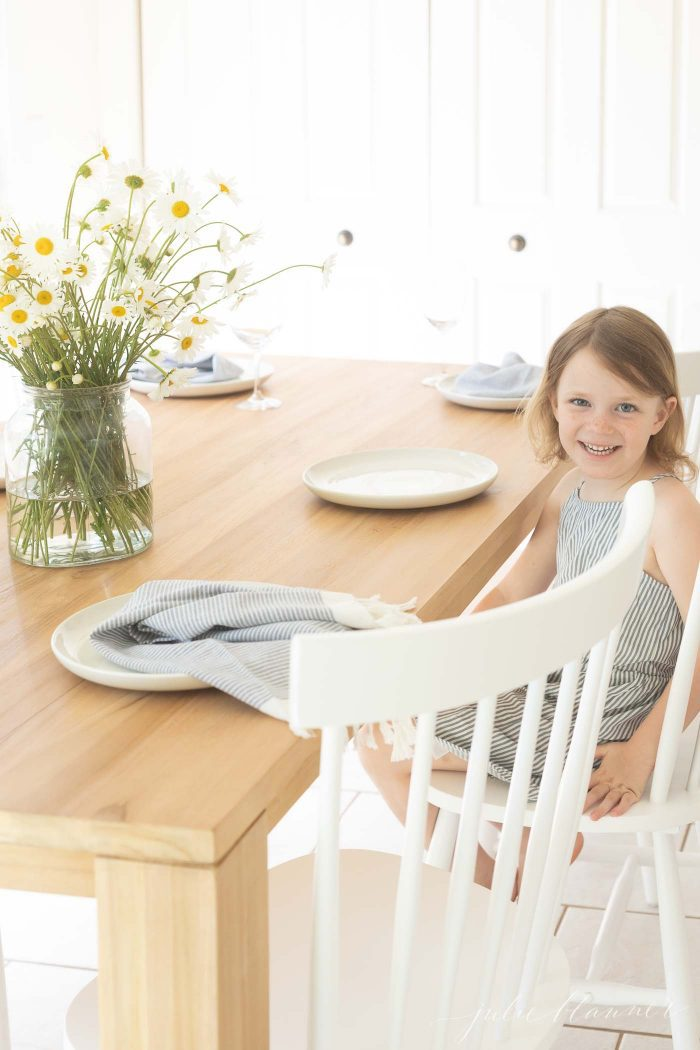 eat in kitchen with child sitting at small dining table