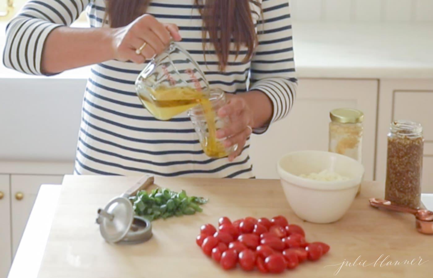 woman in stripe dress combing ingredients in jar