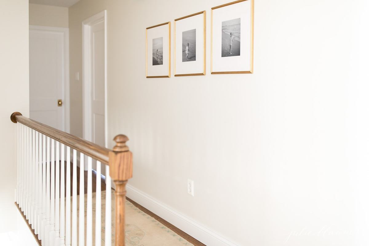 white trim paint in a white hallway of bedroom and bathroom doors.
