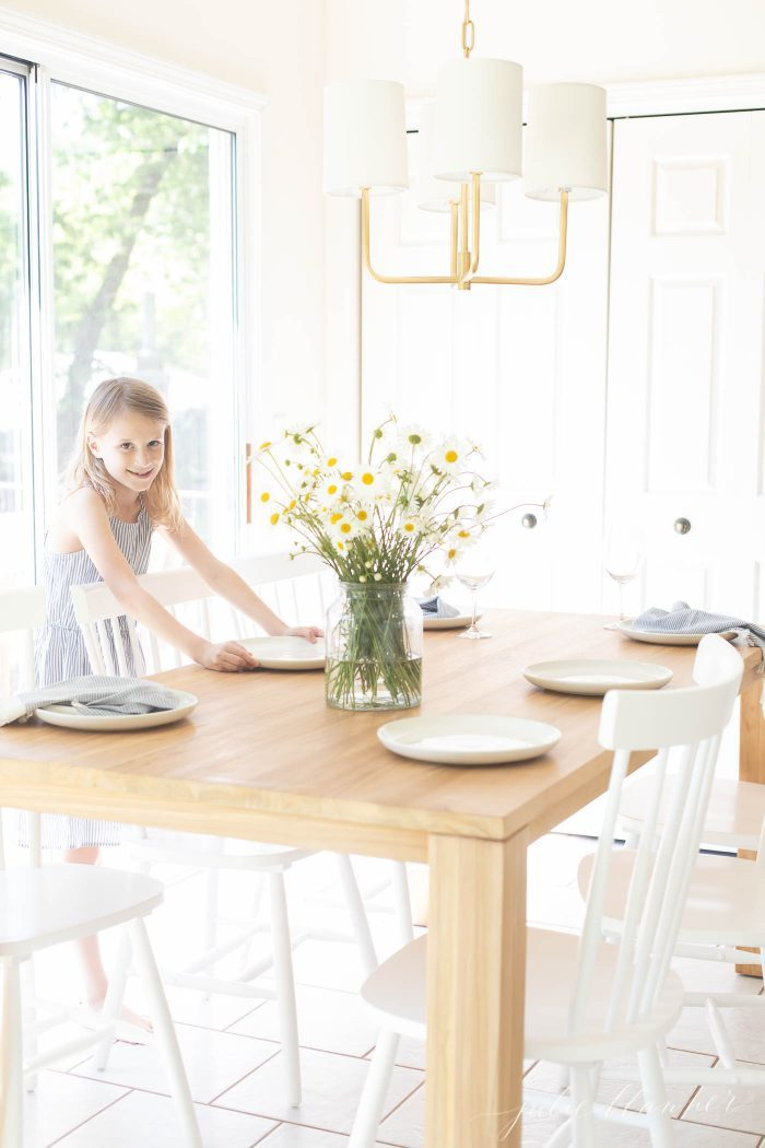 girl setting small dining table