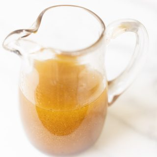 white balsamic vinaigrette in a pourable dressing dispenser