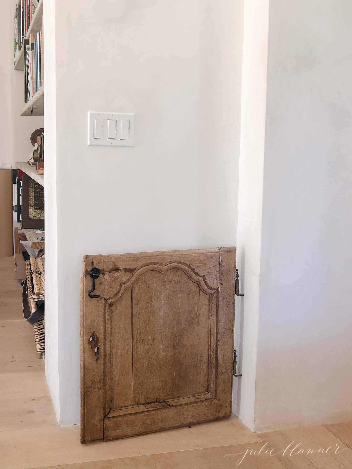 pretty wood doggy door made from reclaimed French cupboard