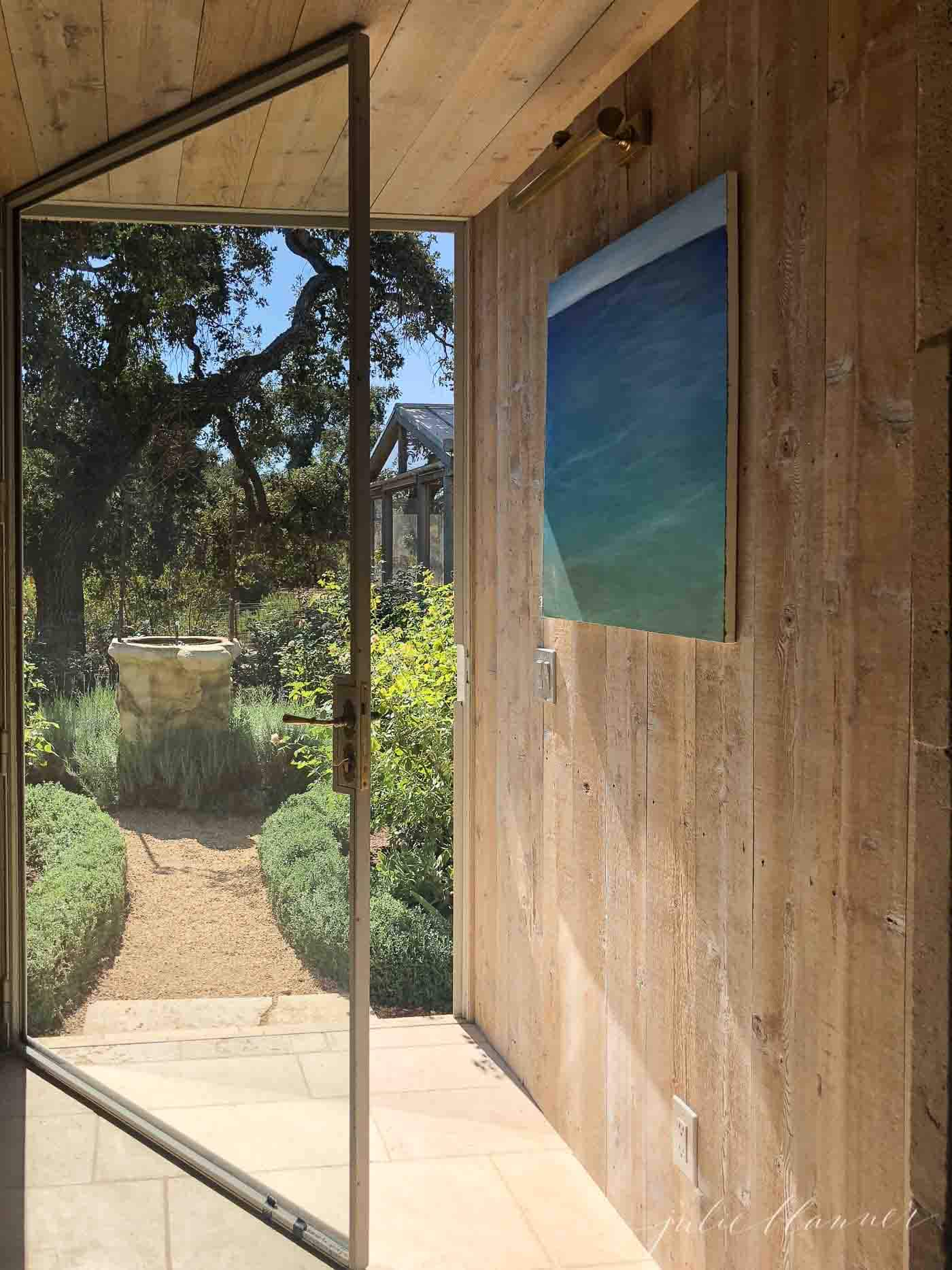 wood wall and large glass door in entryway