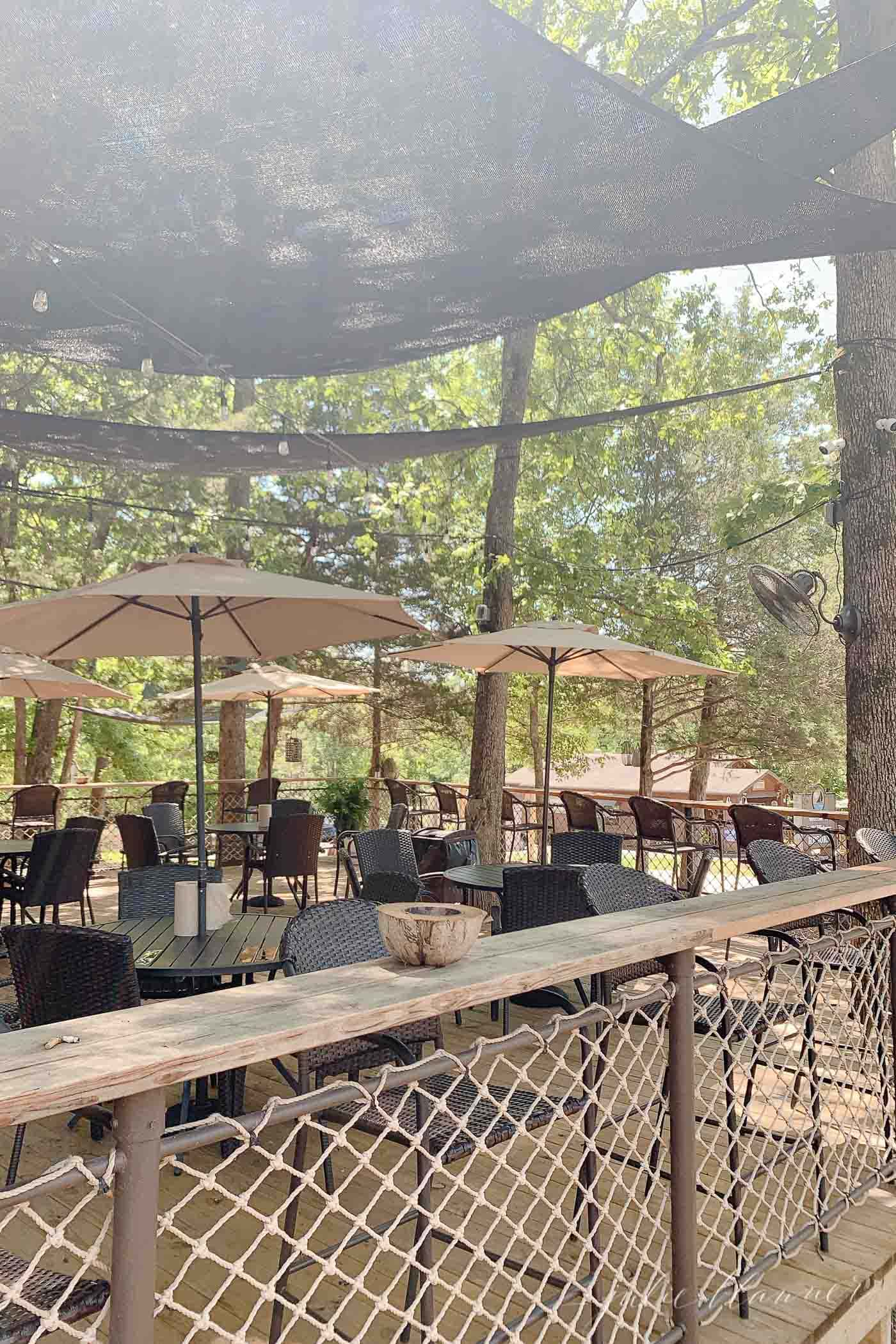 outdoor dining area with umbrellas at stillwater resort
