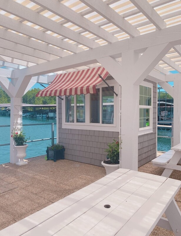 state park marina snow cone shop with stripe awning and pergola