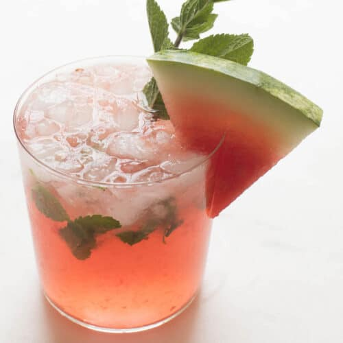 watermelon mojito garnished with mint and a watermelon slice