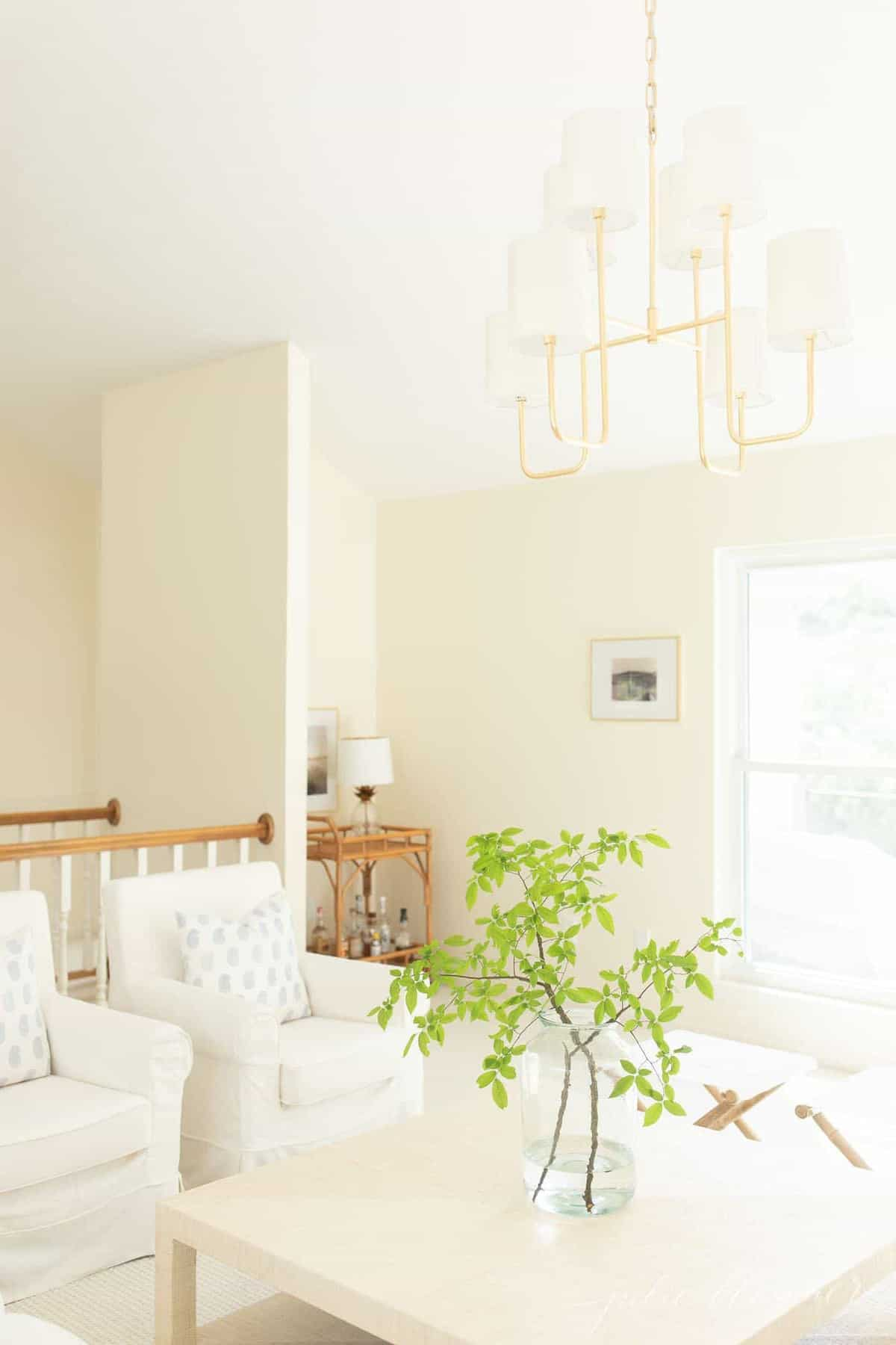 modern living room with cream walls, white ceiling and light colored furnishings.