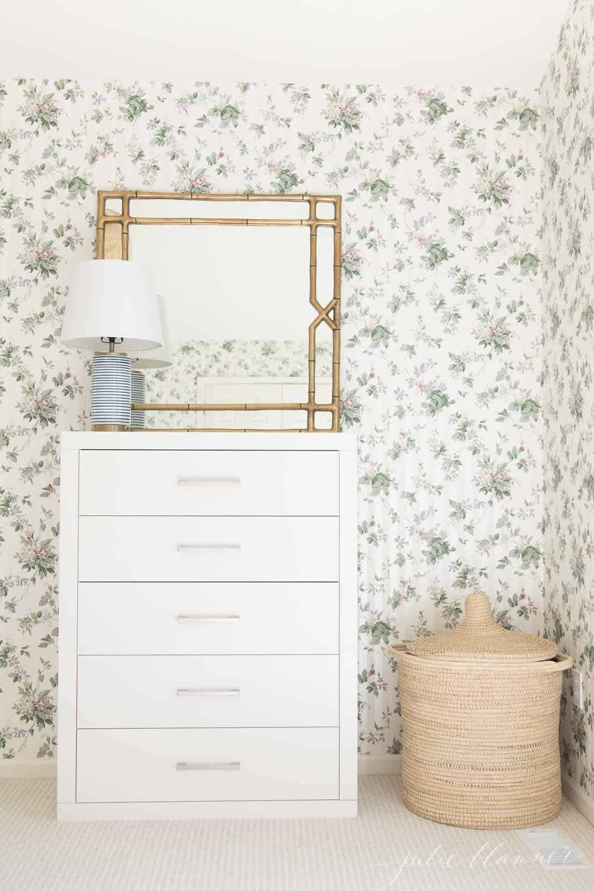 stripe lamp asymmetrical on chest of drawers with mirror behind
