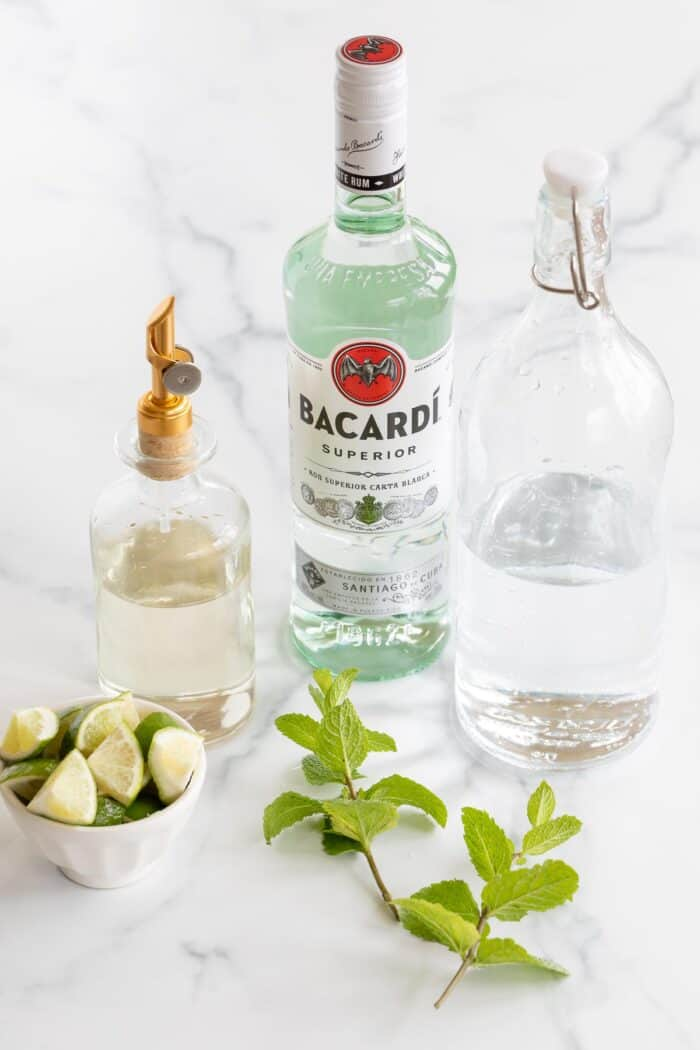 ingredients to make mojitos on marble surface