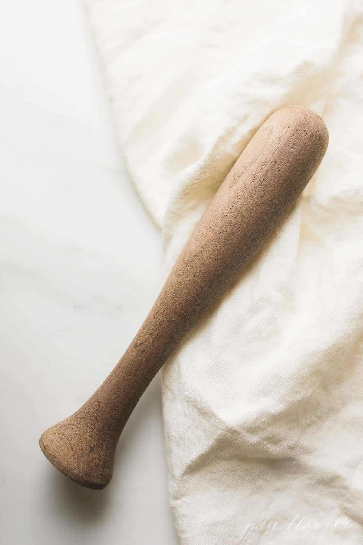 wood mojito muddler on a white surface