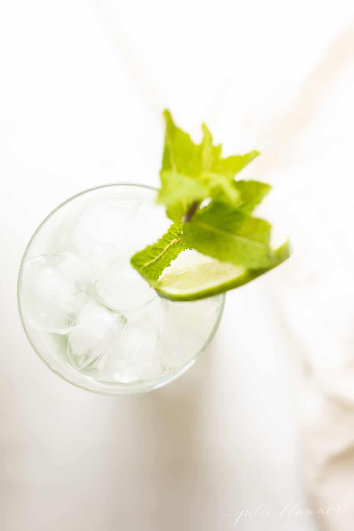 white marble countertop, looking down into an icy glass filled with a mojito.