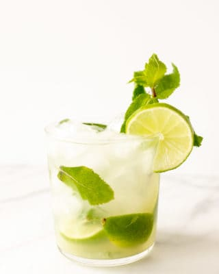 skinny mojito in a short glass with lime and fresh mint
