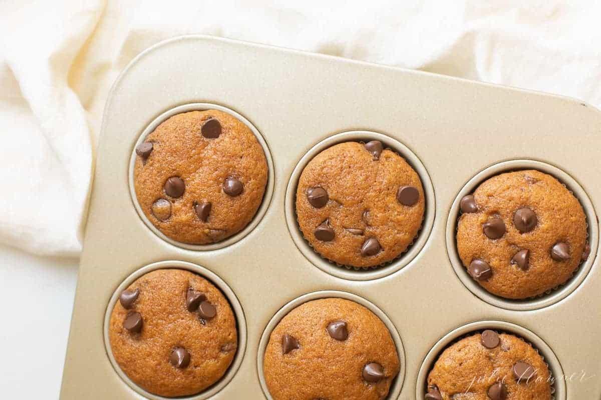 pumpkin chocolate chip muffins in muffin pan