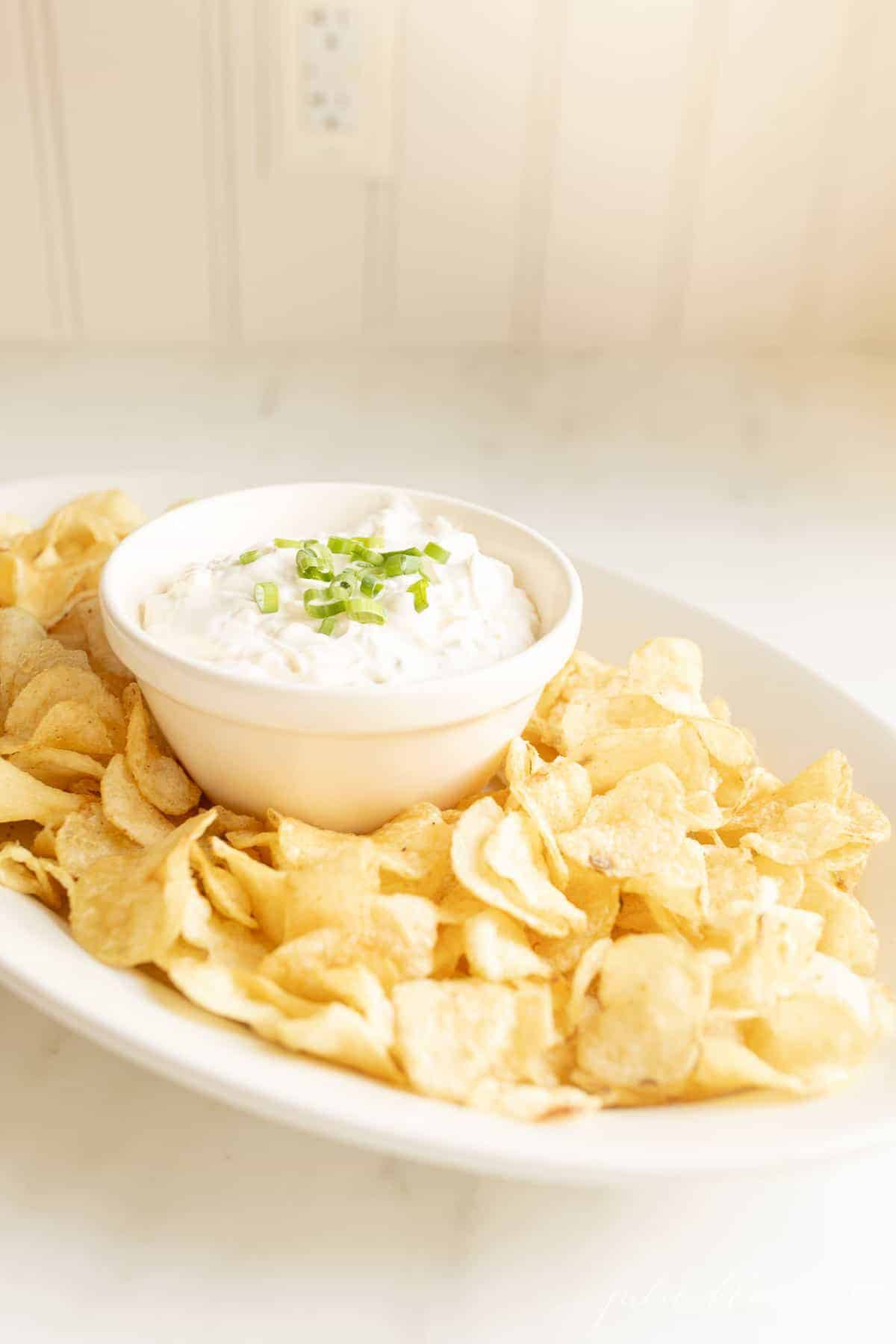 sour cream chip dip on a platter on a kitchen counter