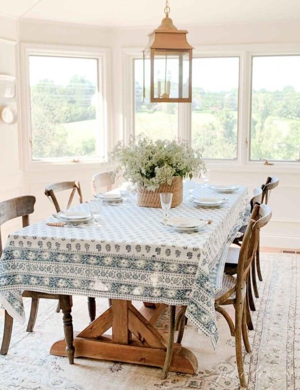 kalamkari table setting in neutral room with brass lantern