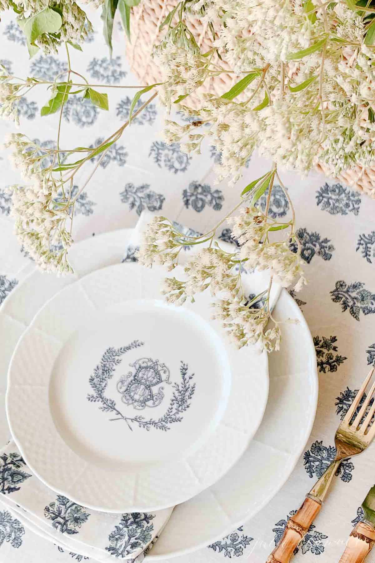 kalamkari block print table cloth with personalized china and wildflowers with bamboo flatware