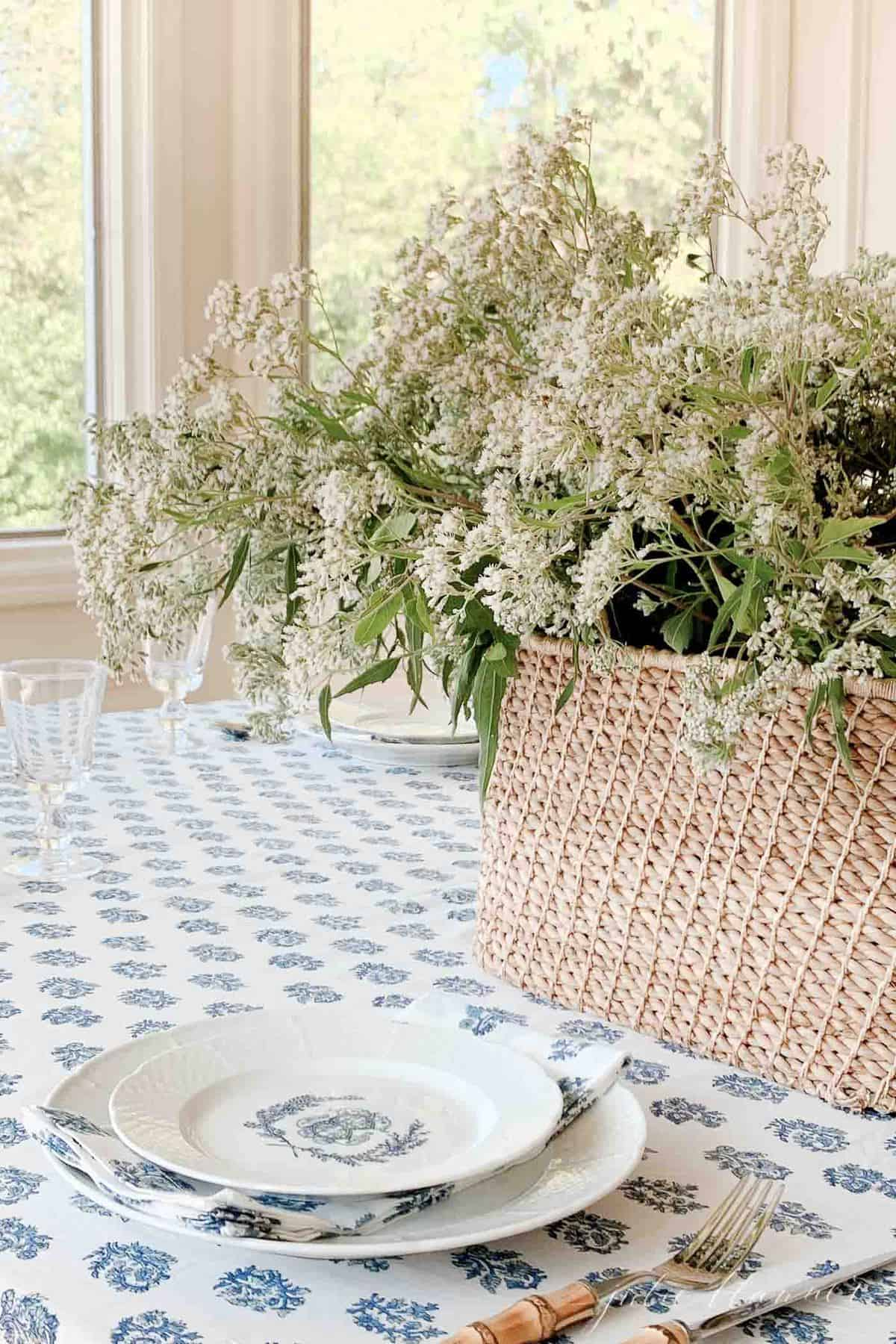 wildflowers in a basket on a kalamakari block print table cloth