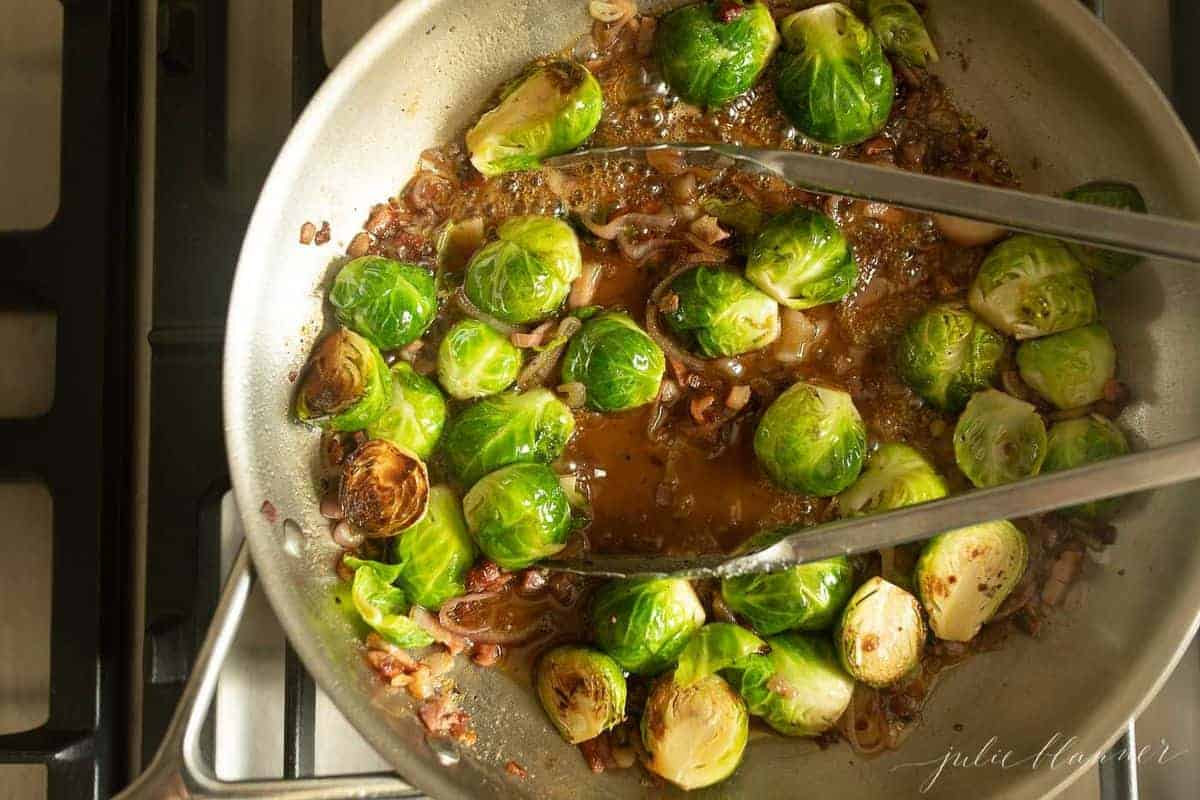 Aluminum pan on the stovetop, fresh pancetta shallots and brussel sprouts cooking down in an agrodolce sauce.