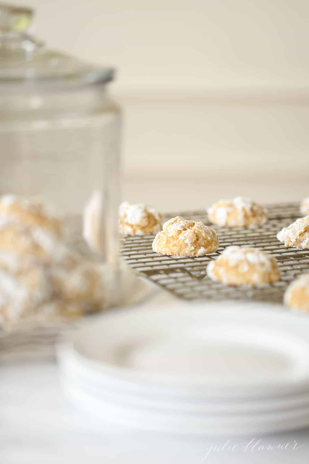 cookies in a cookie jar and on a cooling rack