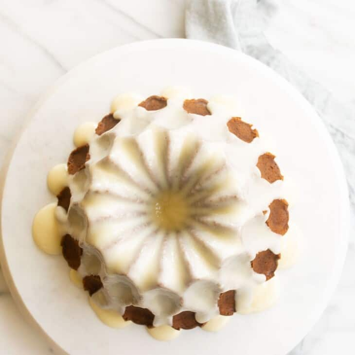 Down shot looking into a pretty bundt cake covered in cream cheese glaze.