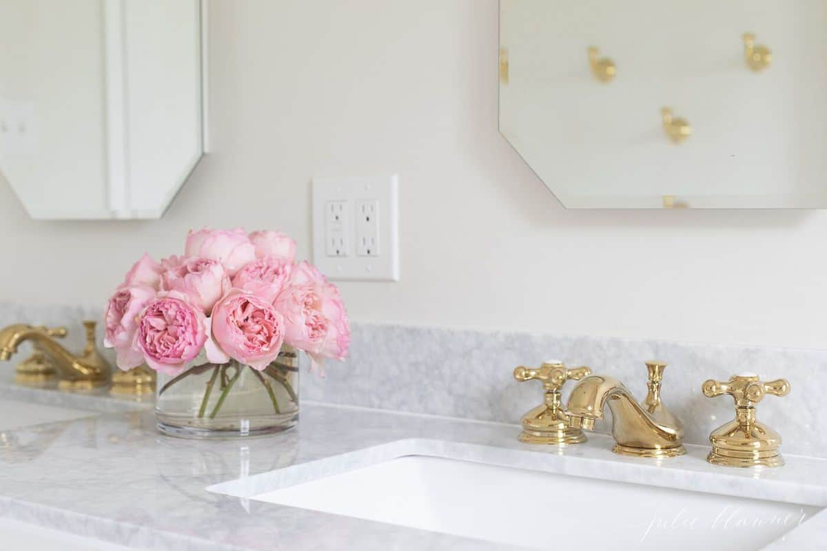 Marble vanity top, mirrored medicine cabinets and a pink bouquet. #spabath