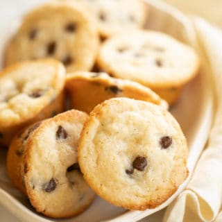 Chocolate chip muffins on a white serving plate