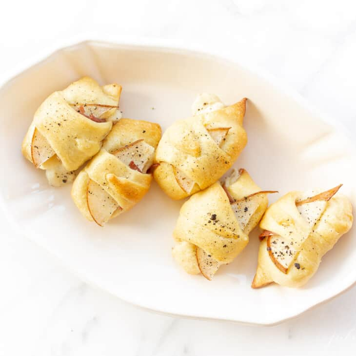 crescent roll appetizer in an ironstone dish
