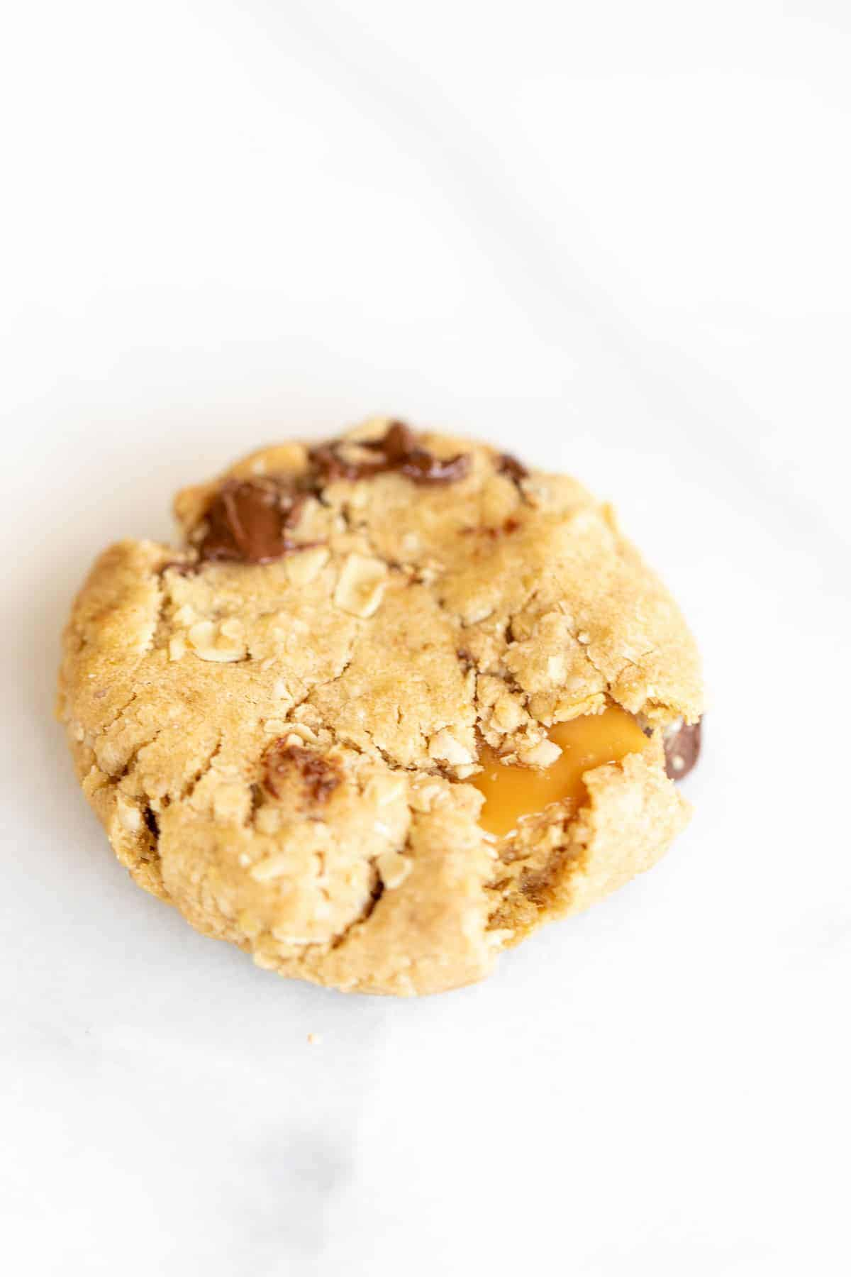 brown sugar oatmeal cookie with chocolate chips stuff with caramel