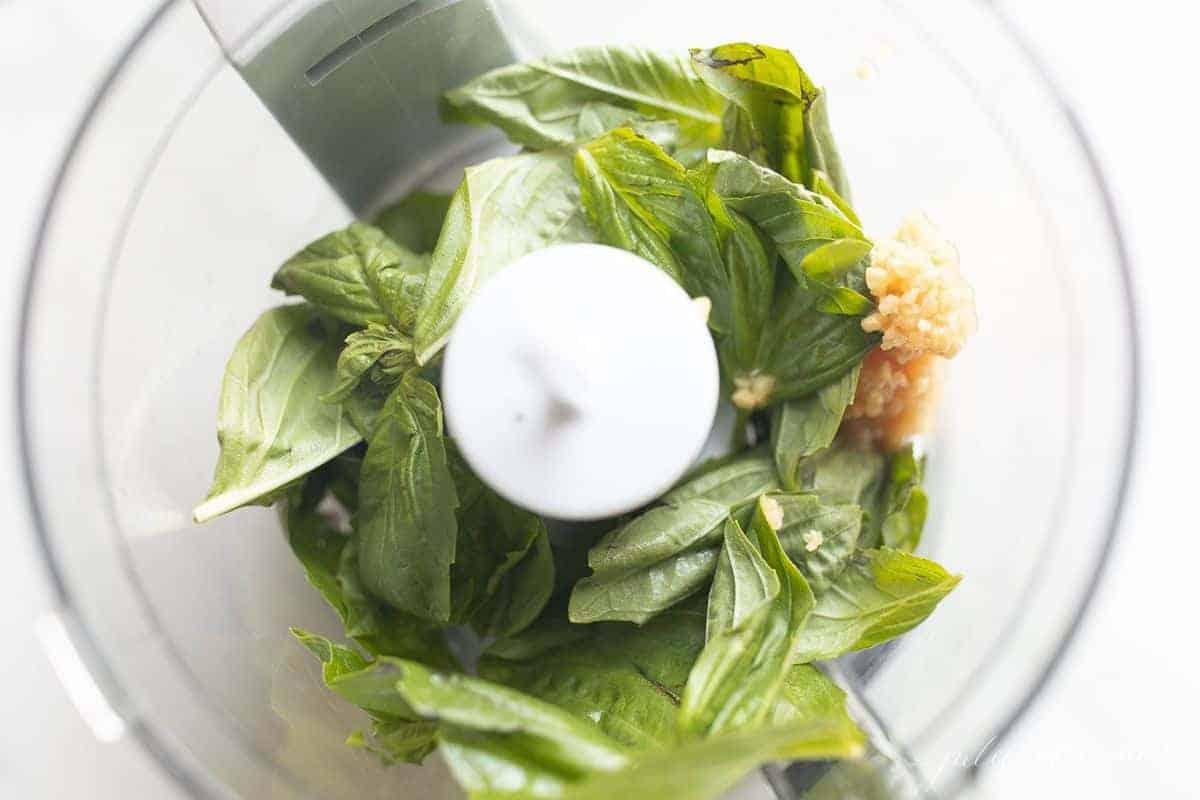 Looking inside a food processor, making pesto aioli.