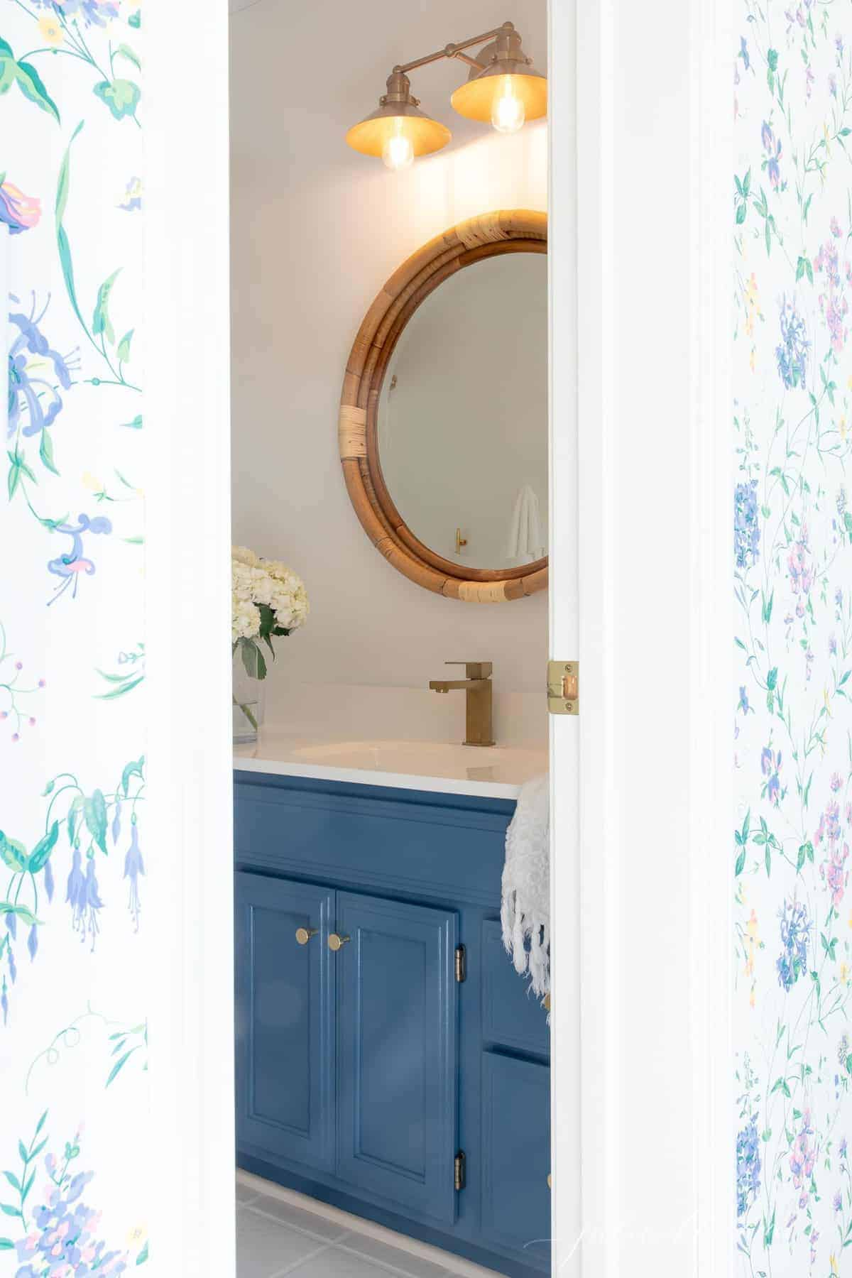 a look inside a white and blue bathroom from nearby bedroom