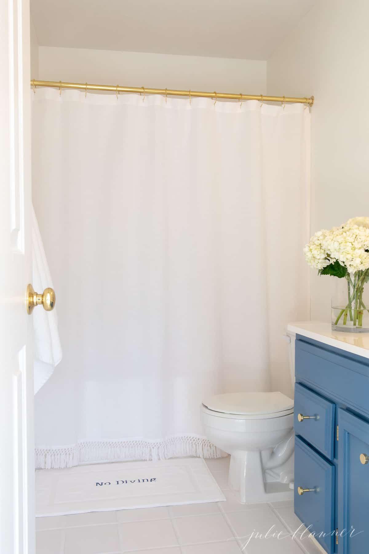 blue vanity in white bathroom