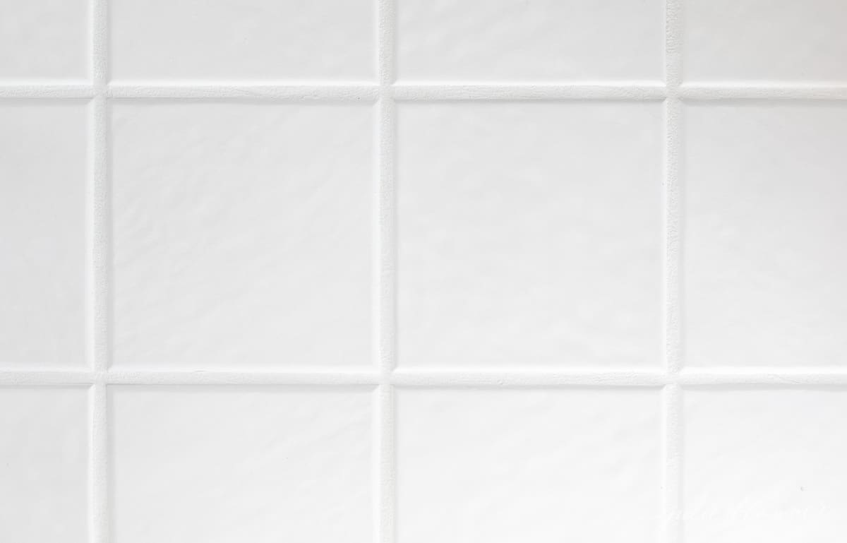 clean tile grout, freshly painted grout lines and white tile