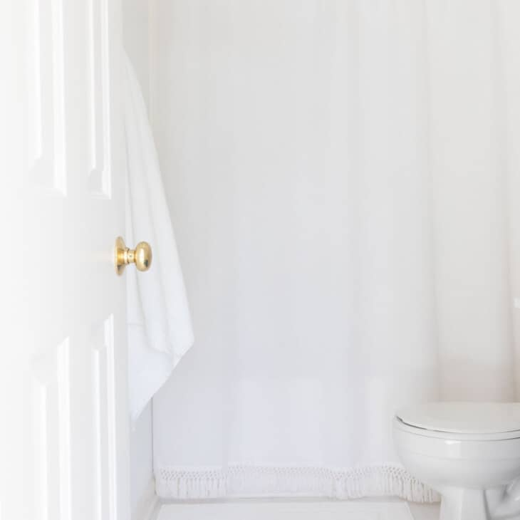 white bathroom with white tile
