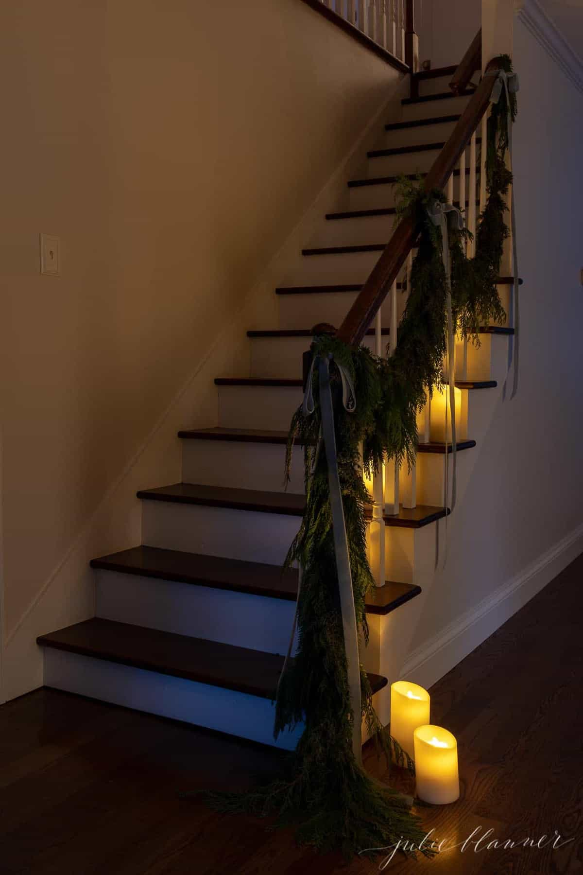 stairs lined in candles and garland for christmas