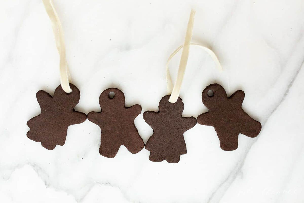 Marble surface, four gingerbread cinnamon ornaments.