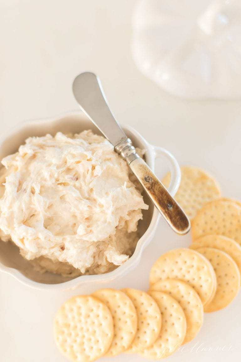 A bowl of dip and crackers to the side.