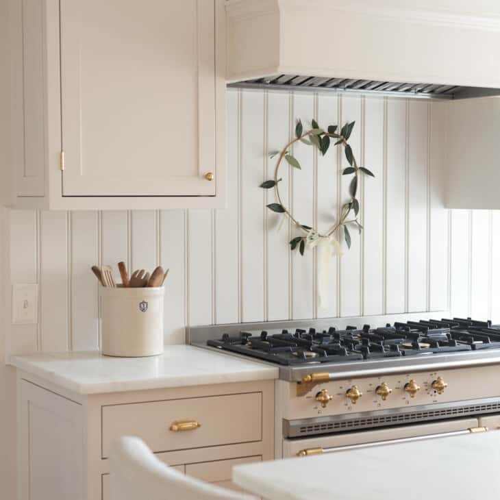 kitchen with minimalist christmas decor a wreath above range