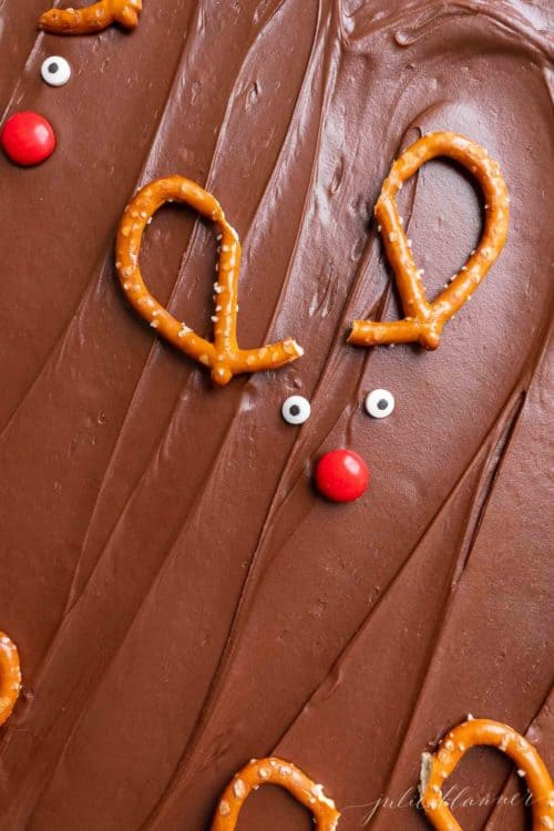 Reindeer brownies decorated with pretzel antlers and red noses.