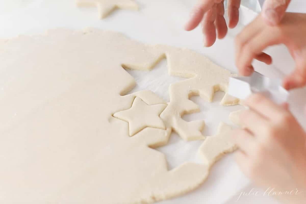 child cutting out salt dough ornaments