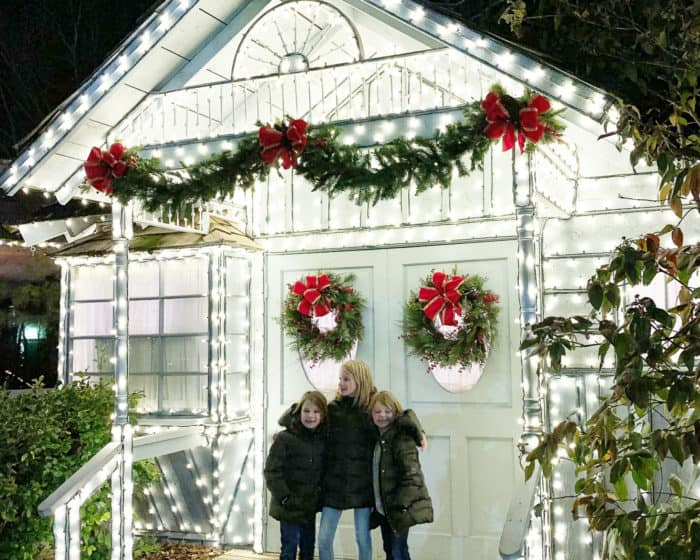 3 girls in front of building lined with lights at silver dollar city