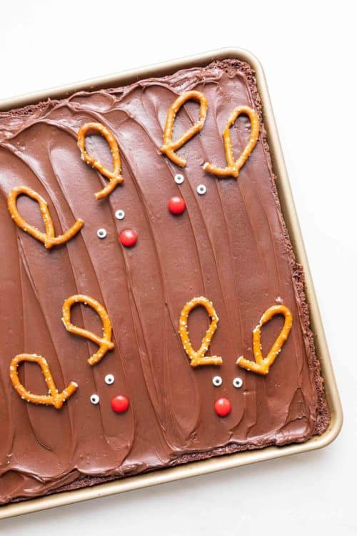 A pan of Christmas brownies decorated with reindeer pretzel antlers.