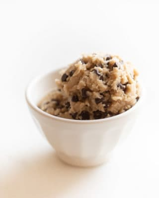 Two scoops of edible cookie dough in a white bowl