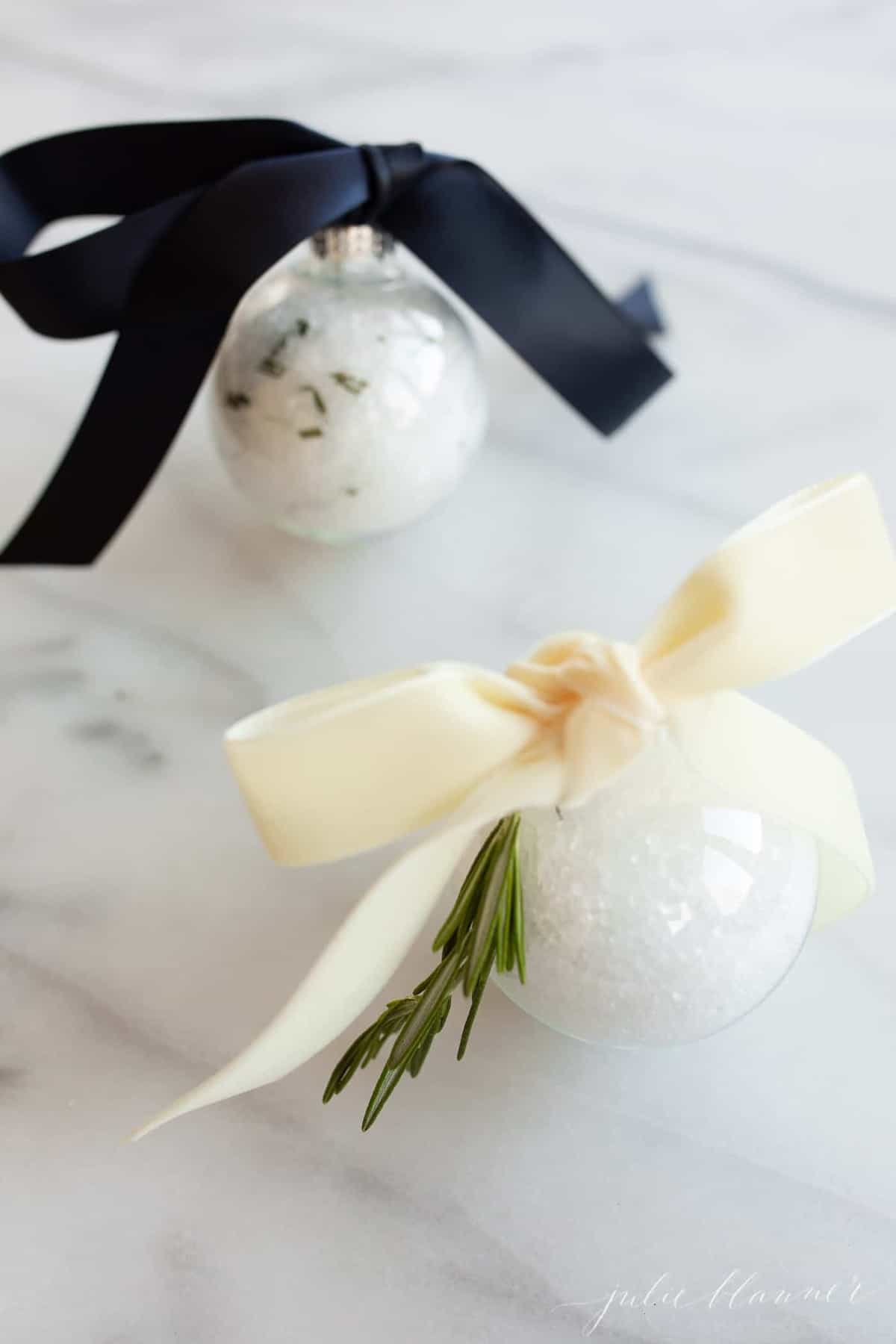 bath soak inside plastic ornaments tied with ribbon
