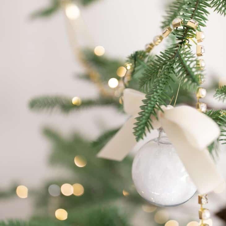 bath salt ornament hanging on tree with lights