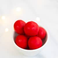 rudolph nose dough balls in a bowl with lights behind